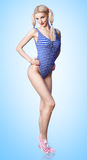 Beautiful woman in fashionable swimsuit. Pinup sexy blonde girl Stock Photo
