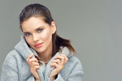 Sensual girl wearing gray coat. Isolated portrait Stock Photos