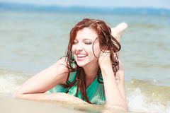 Sensual girl wet cloth in water on the coast. Stock Photo