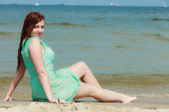 Sensual girl wet cloth in water on the coast. Royalty Free Stock Image