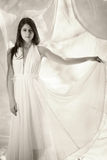 Sensual girl in white dress. Beautiful sensual girl in white dress black and white stock photos