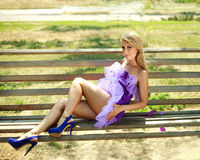 Sensual glamorous girl on bench Royalty Free Stock Photography