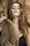Sensual glamour girl with fur Royalty Free Stock Photography