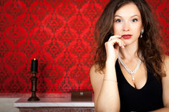 Sensual glamour girl on red vintage background. Inside studio shot Royalty Free Stock Photos