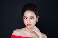 Sensual glamour portrait of beautiful asian woman model lady wit. H red lips color and clean healthy skin face Royalty Free Stock Images