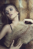 Sensual glamour woman on fur background Stock Photo
