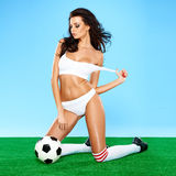 Sensual gorgeous brunette soccer player Royalty Free Stock Photos