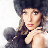 Sensual gorgeous woman wearing black fur in winter Royalty Free Stock Images