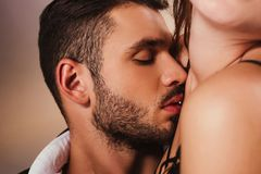 Sensual handsome man cuddling to. Young woman royalty free stock photo