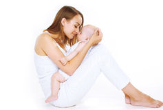 Sensual happy mother and sleep baby Stock Photography