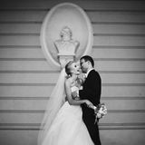 Sensual, happy newlywed valentynes hugging, wall with bust backg Royalty Free Stock Image