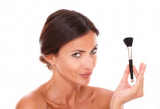Sensual hispanic female with make up brush Royalty Free Stock Photo