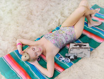 Sensual hot body young woman with colorful details relax on the Royalty Free Stock Photo