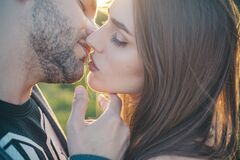 Sensual Kiss. Close-up of beautiful passionate couple kissing. Sexy couple In Love. Intimate relations. Mouths kissing