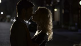 Sensual kiss of two loving people, romantic couple enjoying date, evening time. Stock footage stock video footage