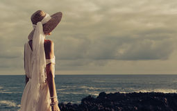 Sensual lady at the beach in hat and jewelry accessories at suns. Et Stock Images