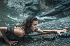 Sensual lady hiking on the wet rocks. Sensual woman hiking on the wet rocks Stock Photography