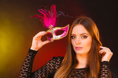 Sensual lady holding carnival mask. Royalty Free Stock Image