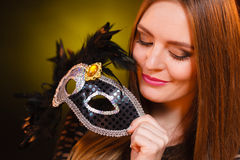 Sensual lady holding carnival mask. Sensuality celebrations people concept. Sensual lady holding carnival mask. Young woman has amazing and delicate make up Stock Photography