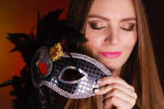Sensual lady holding carnival mask. Sensuality celebrations people concept. Sensual lady holding carnival mask. Young woman has amazing and delicate make up Stock Photos