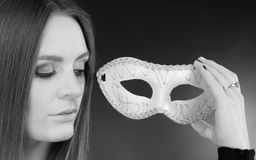 Sensual lady holding carnival mask. Sensuality celebrations people concept. Sensual lady holding carnival mask. Young woman has amazing and delicate make up Royalty Free Stock Photo