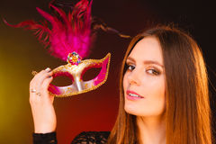 Sensual lady holding carnival mask. Sensuality celebrations people concept. Sensual lady holding carnival mask. Young woman has amazing and delicate make up Stock Image