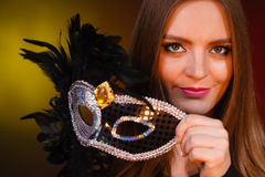Sensual lady holding carnival mask. Sensuality celebrations people concept. Sensual lady holding carnival mask. Young woman has amazing and delicate make up Royalty Free Stock Images