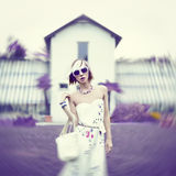 Sensual lady in lavender color. On park background stock image