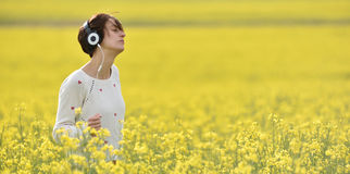 Sensual lady listening music in headphones and dancing in a cano Stock Images