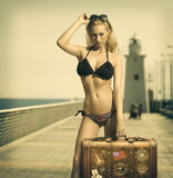 Sensual lady ready to travel in vintage color Stock Photos