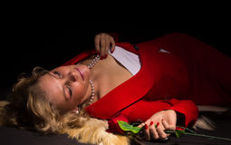 Sensual  lady in red with rose Royalty Free Stock Photography