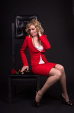 Sensual lady in red with snake Stock Photos