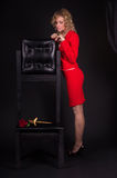 Sensual lady in red with snake Stock Images