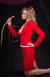 Sensual lady in red with snake Royalty Free Stock Images