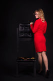 Sensual lady in red with snake Stock Photo