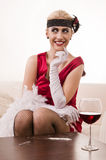 Sensual lady in red sniffing cocaine (Imitation) Royalty Free Stock Photos