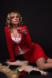 Sensual  lady in red with wine glass in a hand Stock Photo