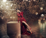 Sensual lady in shiny gold place Stock Images