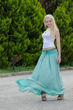 Sensual lady wears blue long skirt Royalty Free Stock Images