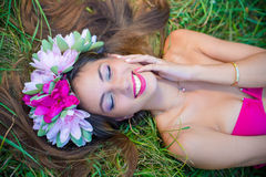 Sensual lady in wreath and perfect smile on grass Royalty Free Stock Image
