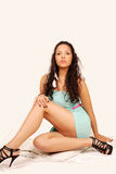 Beautiful latino female in seated pose. Portrait of beautiful young woman in sitting pose Stock Photography