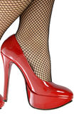 The sensual legs in fishnet stockings Stock Photos
