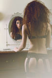 Sensual lingerie woman reflected in the mirror Royalty Free Stock Photo