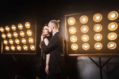Sensual look at camera. Back side. Romantic perfect couple. Studio shot, stage Stock Image