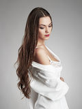 Sensual love with a girl.young woman with long hair. Beauty model in white underwear and man shirt stock photography