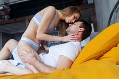 Sensual loving couple in the bedroom making love. stock photography