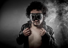 Sensual male biker with sunglasses era dressed Leather jacket, h Royalty Free Stock Images