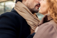 Sensual man and woman enjoying first kiss royalty free stock photography