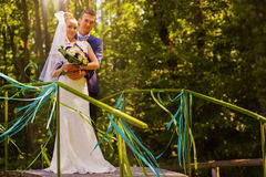 Sensual married couple on bridge Stock Photos