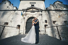 Sensual married couple, valentines hugging in front of old slavi. C castle Royalty Free Stock Photo